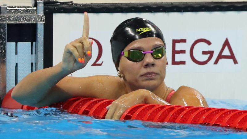 Champion Swimmer's Doping Past Stirs Up Waves in Olympic Pool