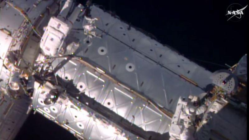 Spacewalking Astronauts Install New Door for Visitors