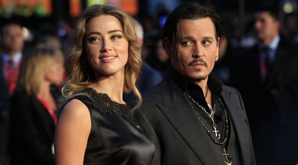 Amber Heard calls on Johnny Depp to double divorce charity payout
