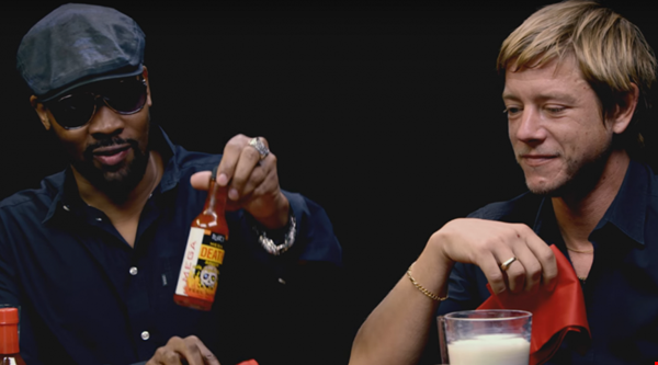 RZA and Paul Banks take on the Hot Ones challenge