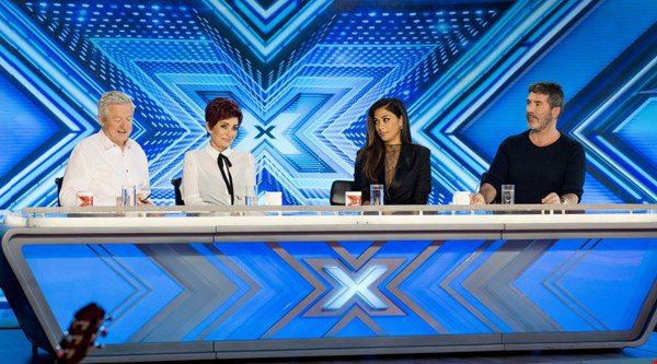 The X Factor's old school judging panel is rocking everyone's socks